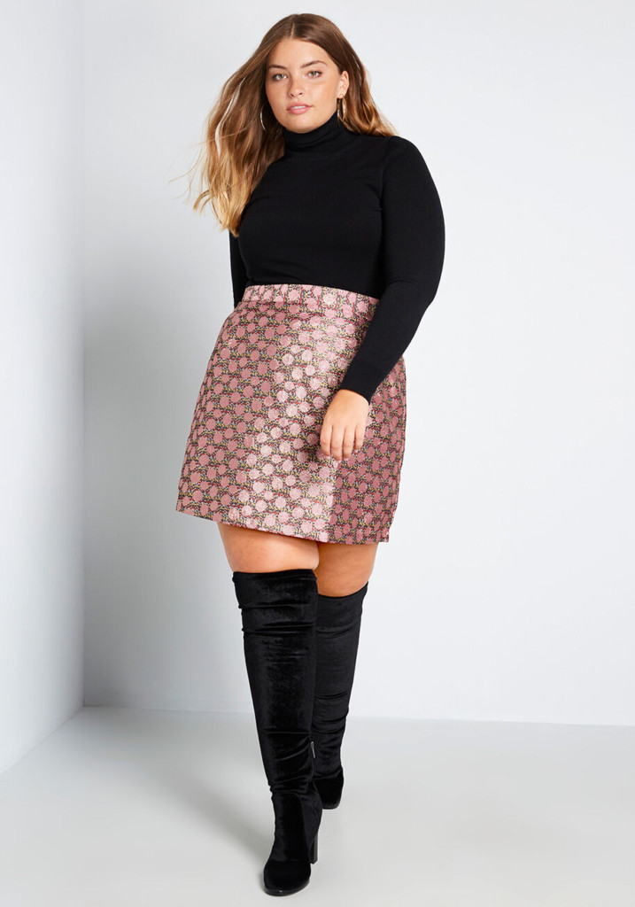 woman posing in a pink plus size skirt